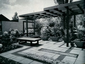 As a focal point of interest, a garden shelter becomes the major accent in an outdoor living area.