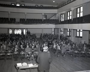 img902__woodward-production-credit-assn_meeting-in-convention-hall_1951